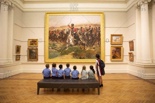 Sydney, Australia - October 18, 2017: Group of children viewing painting at the Art Gallery of New South Wales