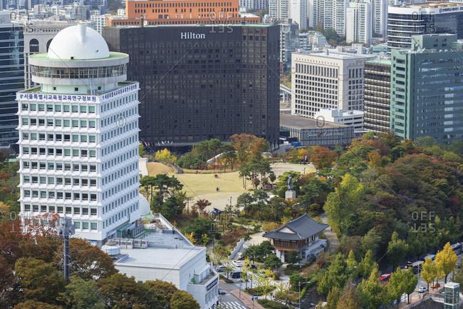 October 25, 2019: Namsan Baekbeom Park and skyscrapers, Seoul, South Korea, Asia