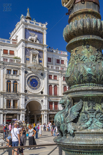 September 12, 2019: View of Torre dell'Orologio and ornate lamp post in St. Mark's Square, Venice, UNESCO World Heritage Site, Veneto, Italy, Europe
