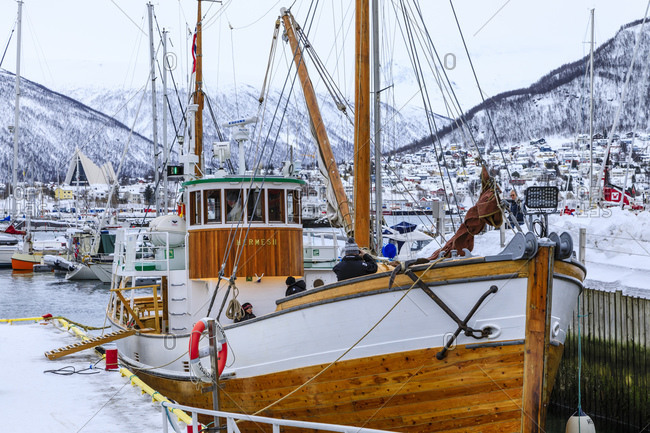 March 5, 2020: Small boat harbor, fjord, Arctic Cathedral, deep snow in winter, Tromso, Troms og Finnmark, Arctic Circle, North Norway, Scandinavia, Europe