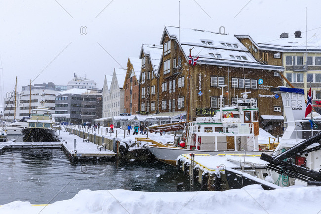 March 6, 2020: Tromso small boat harbor, heavy snow in winter, Tromso, Troms og Finnmark, Arctic Circle, North Norway, Scandinavia, Europe
