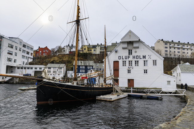 March 8, 2020: Beautiful Alesund, waterfront, historic boat, wooden warehouse in winter, Alesund, More og Romsdal, Norway, Scandinavia, Europe