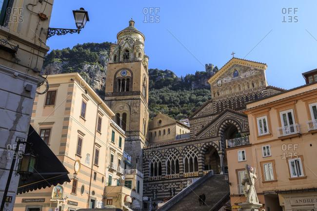 March 22, 2019: Cathedral, blue sky, sun, Amalfi, Costiera Amalfitana (Amalfi Coast), UNESCO World Heritage Site, Campania, Italy, Europe