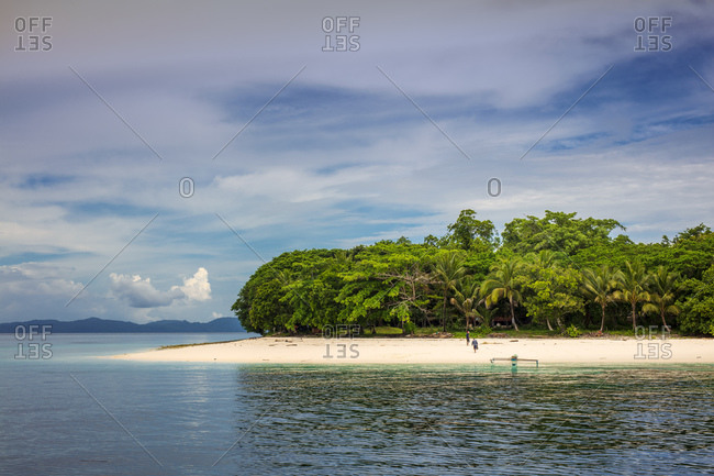 An outrigger canoe on a deserted beach, Pulau Molana Island, Ambon, Maluku, Spice Islands, Indonesia, Southeast Asia, Asia