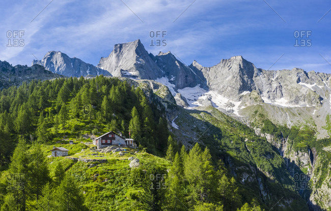Sasc Fura hut with the famous Pizzo Badile in the background, Bondasca valley, Bregaglia valley, Graubunden, Switzerland, Europe