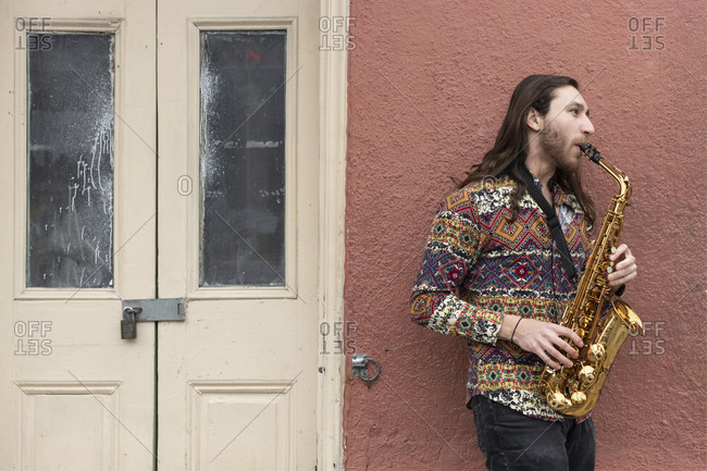 February 6, 2020: Saxophone player on a Bourbon Street corner in the French Quarter of New Orleans, Louisiana, United States of America, North America
