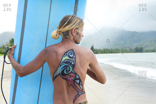 April 23, 2014: Surfer in Hanalei Bay, with a shark painted on his back, Kauai, Hawaii, United States of America, North America