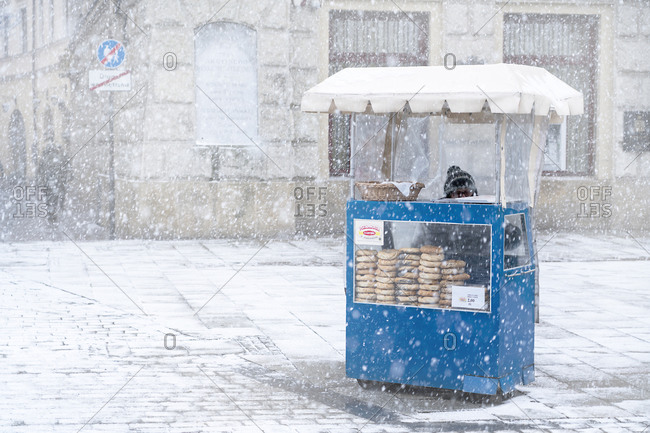 January 3, 2019: Traditional Krakow bagel seller in the snow located at the City Square, Krakow, Poland, Europe
