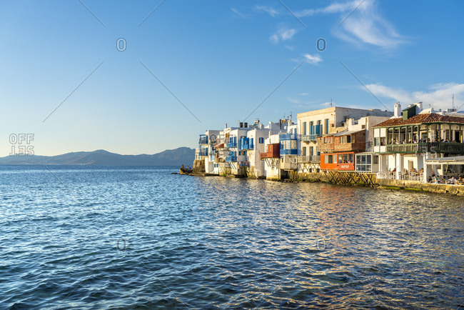October 1, 2018: Mykonos Town at sunset with mountains in background, Mykonos, Cyclades, Greek Islands, Greece, Europe