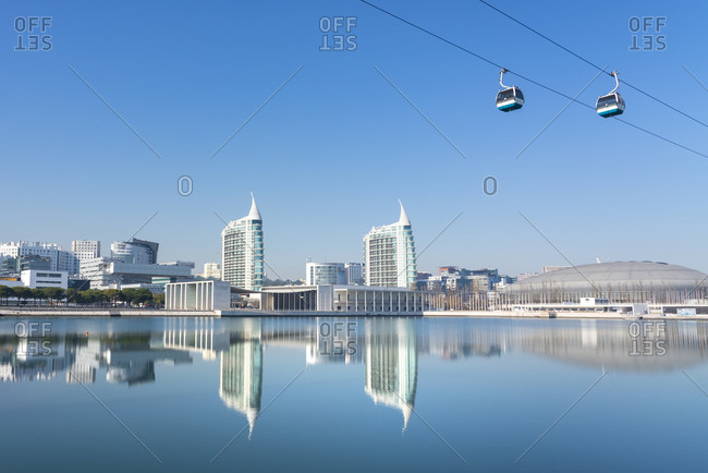 January 14, 2019: Reflection of Pavilhao de Portugal, Expo 98, with cable car, in Parque das Nacoes (Park of the Nations), Lisbon, Portugal, Europe