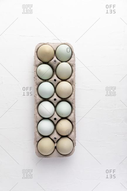 Dozen fresh farm eggs in crate