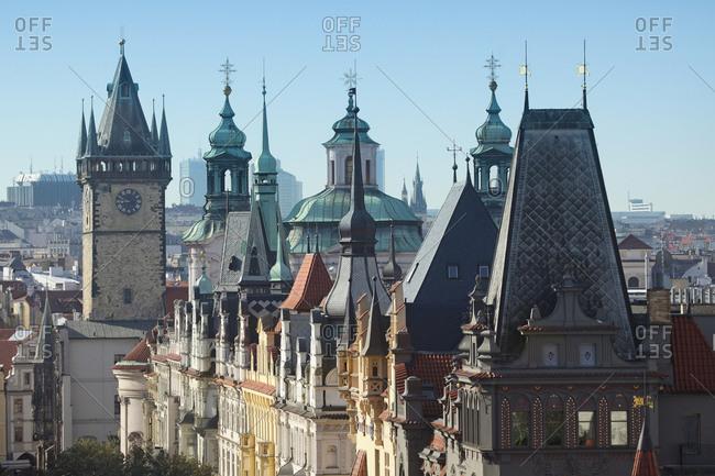 Czechia- Prague- along Parizska street- Houses and Towers of Townhall and St Nicholas Church