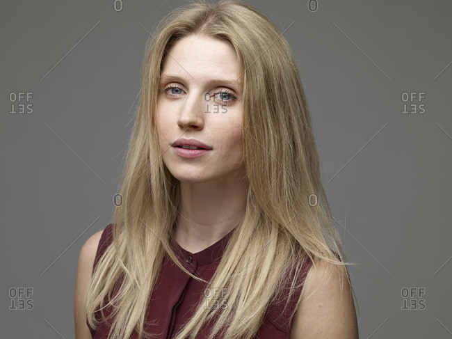 Portrait of daydreaming blond young woman