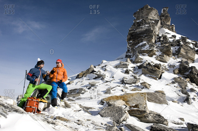Austria- Men having rest on peak at Salzburger Land