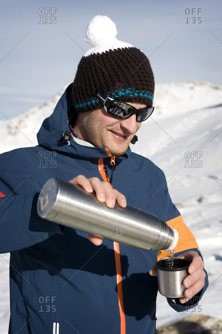 Austria- Man drinking tea- smiling