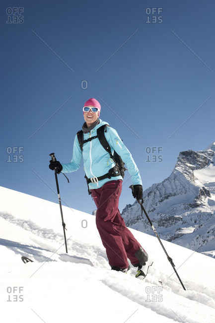 Austria- Woman skiing on mountain at Salzburger Land
