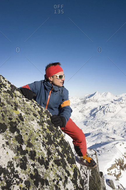 Austria- Man trekking on peak at Salzburger Land