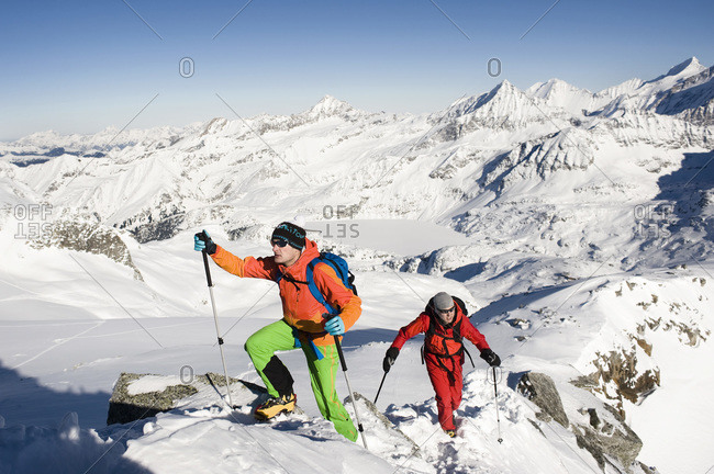 Austria- Men skiing on mountain at Salzburger Land