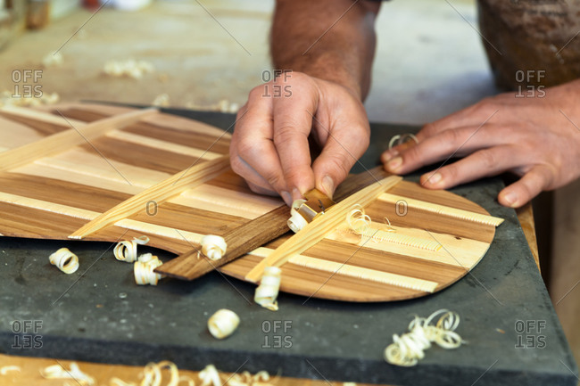 Guitar maker in his workshop- close-up