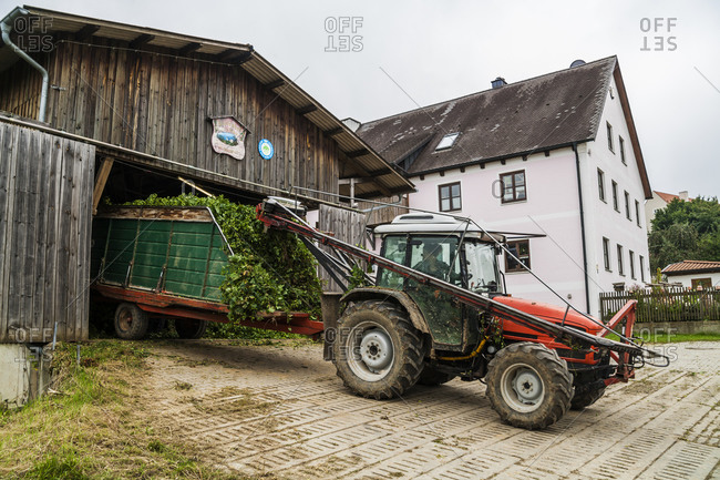 Germany- Bavaria- Attenhofen- travtor with hop at barn