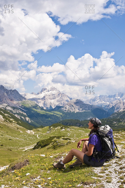 Italy- South Tyrol- Dolomites- Fanes-Sennes-Prags Nature Park- hiker sitting in alpine meadow