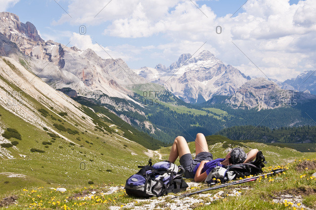 Italy- South Tyrol- Dolomites- Fanes-Sennes-Prags Nature Park- hiker lying in alpine meadow