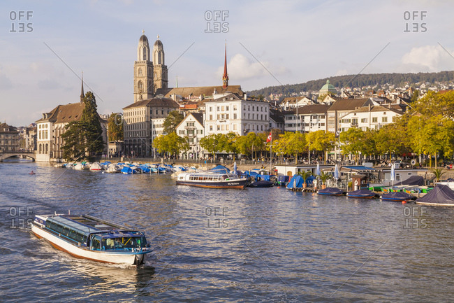 Switzerland- Zurich- view of city with tour boat on Limmat in the foreground