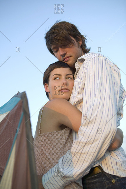 Young couple embracing- low angle view