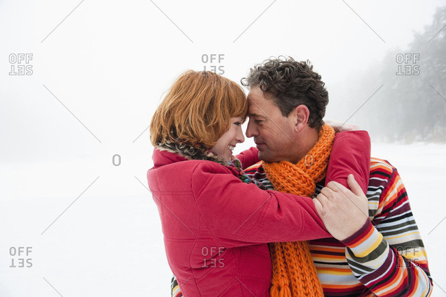 Italy- South Tyrol- Seiseralm- Couple embracing- smiling- head to head