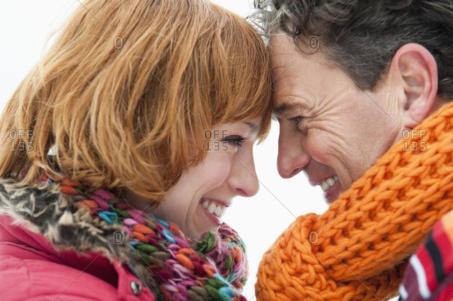 Italy- South Tyrol- Seiseralm- Couple head to head- smiling- portrait- close-up