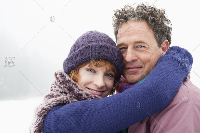 Italy- South Tyrol- Seiseralm- Couple embracing- smiling- portrait- close-up
