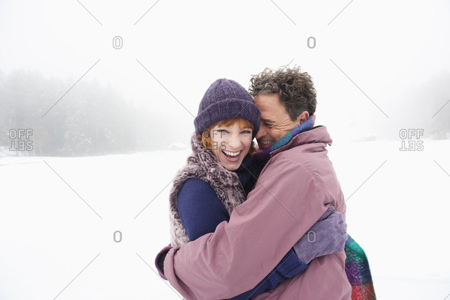 Italy- South Tyrol- Seiseralm- Couple embracing- smiling- portrait