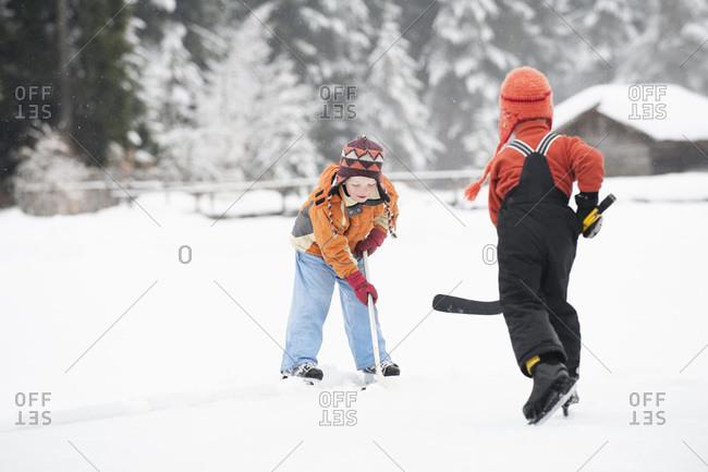 Italy- South Tyrol- Seiseralm- Two Boys playing ice hockey
