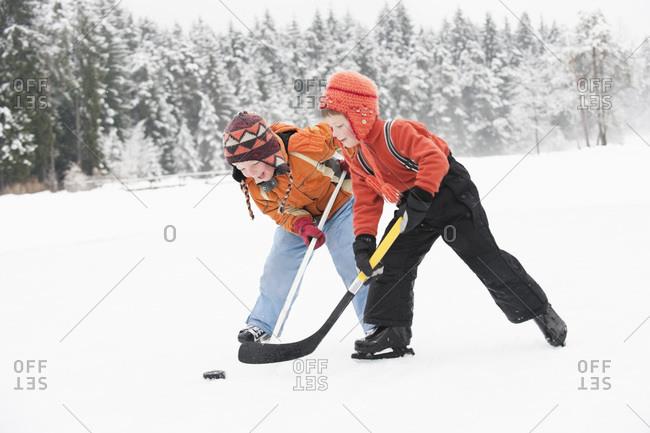 Italy- South Tyrol- Seiseralm- Two Boy`s playing ice hockey