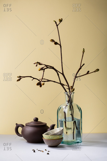 Clay teapot on gray table