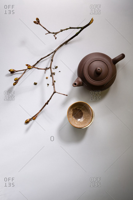Teapot and teacups on gray surface