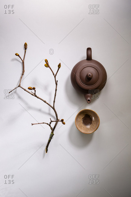 Overhead view of Teapot and teacups on gray surface