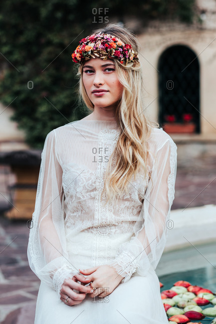 Young bride with wreath and flowers