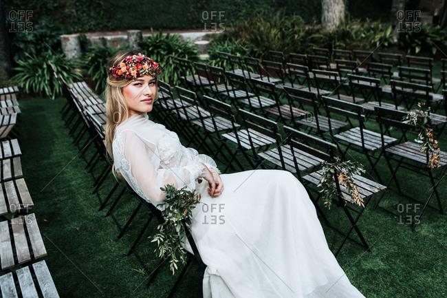 Elegant bride resting on guest seats