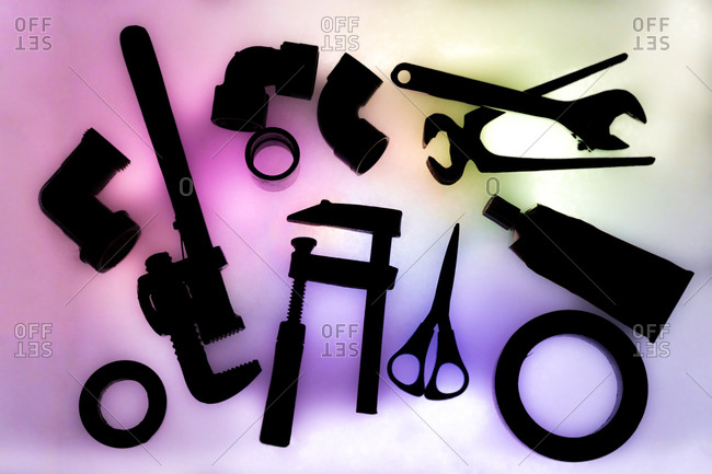 Set of various craft tools on colorful background