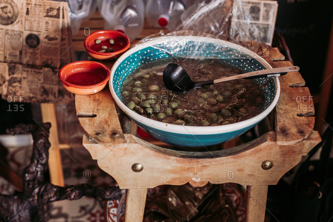 Big bowl of marinated olives while in local delicatessen rustic food store