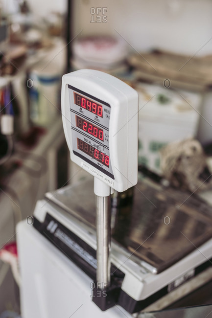 From above weighing machine with electronic display placed on counter in local food store