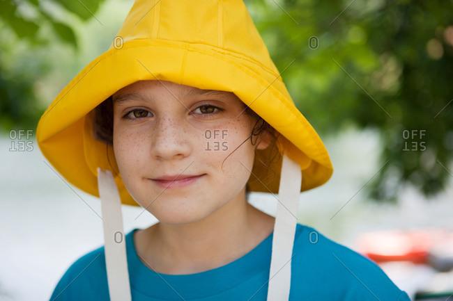 Portrait of girl wearing yellow rain hat