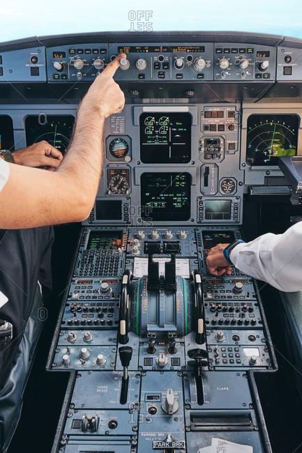 Pilots working in cockpit during flight