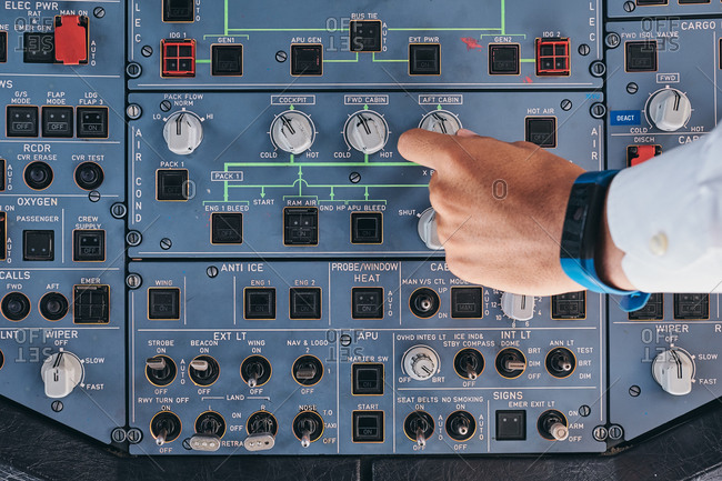 Pilot working with control console during flight
