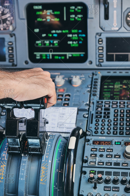 Pilot operating airplane in cockpit