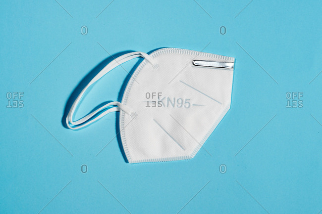 White mask with reusable KN95 protection index for virus protection on light blue background