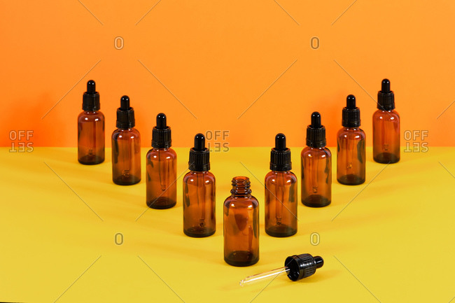 glass vials with dropper system for medical use V-shaped composition with the first one with the dropper supported