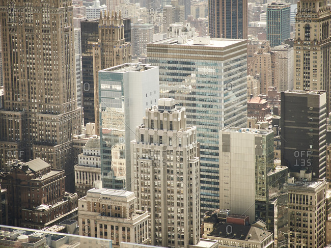 Aerial view of modern New York city district with glass high rise towers in sunlight