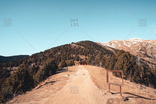 Lonely house in mountainous valley in sunny day